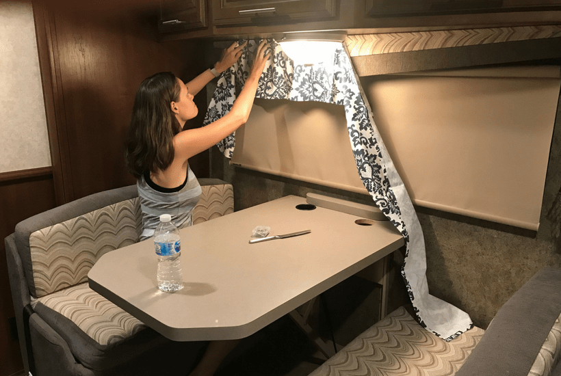Update and re-cover your RV window valances and bring them into the modern day. DIY RV renovations aren't all difficult and drawn out. They can be ask easy as no sew valances for as little as $40! This rv makeover window treatments are a must for those ugly valance boxes! #rvmakeover #rvrenovation #diyrvrenovations #rvlife #rvliving