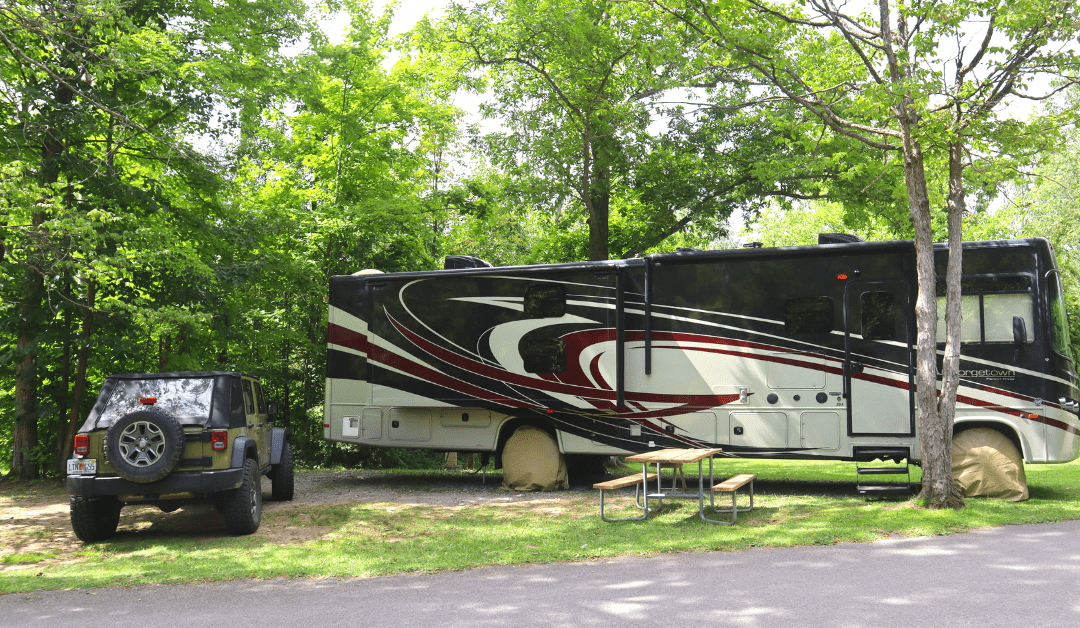 RV PARKED IN STATE PARK WITH JEEP CHRISTMAS GIFTS FOR FULL TIME RVERS